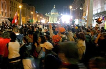 Pilgrims walk up Via della Conciliazione towards Saint Peter's square in Vatican City.