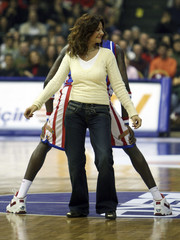 Turkish basketball fan dances with Kevin Daley of Harlem Globetrotters during exhibition game with NY Nationals in Istanbul
