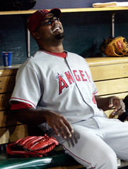 Los Angeles Angels of Anaheim starting pitcher Escobar smiles in the dug-out during their MLB game against the Detroit Tigers in Detroit