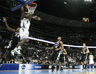 Michigan State forward Raymar Morgan drives past Temple forward Lavoy Allen during the first half of their first round NCAA men's basketball tournament game in Denver