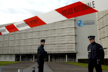 FRENCH POLICE STAND IN FRONT OF A BUSINESS SCHOOL CORDONED OFF AFTER BOMB EXPLOSION IN NANTES.