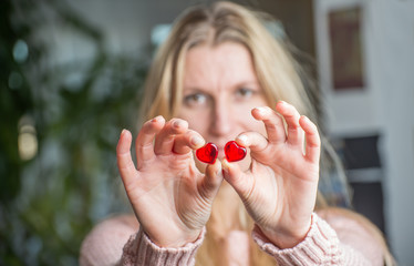 Close up of a woman's hands holding a red hearts
