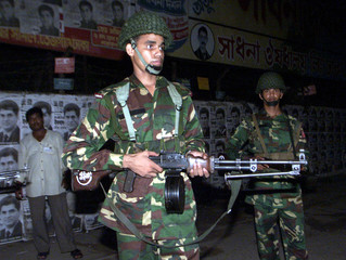 BANGLADESH TROOPS GUARD OUTSIDE A POLLING CENTRE.
