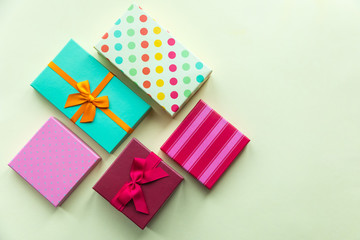 Holidays giftboxes on the pastel yellow background for mother's day, birthday, valentines day