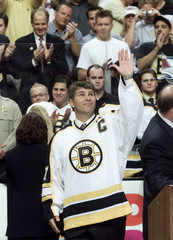 BOURQUE WAVES GOODBYE TO BOSTON CROWD AFTER HIS BRUINS NUMBER WASRETIRED.