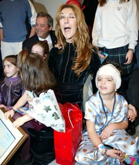 CELINE DION WINKS AS SHE HAS HER PICTURE TAKEN WITH SICK CHILDREN INMONTREAL.