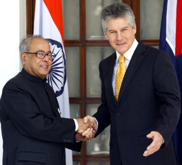Australia's FM Smith shakes hands with his Indian counterpart Mukherjee in New Delhi