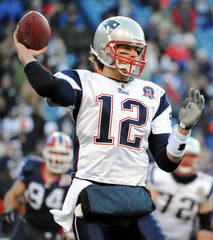 New England Patriots quarterback Tom Brady throws downfield against the Buffalo Bills during NFL football action