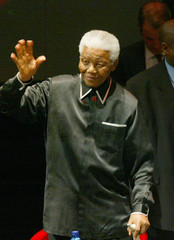 Former president Mandela waves to well-wishers as he celebrates birthday in Johannesburg.