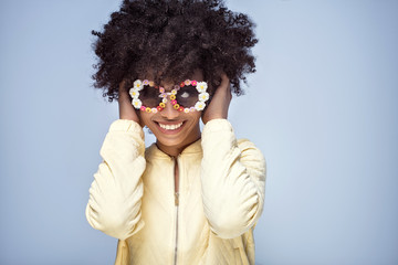 Portrait of smiling african girl with sunglasses.