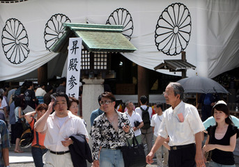 People visit Yasukuni Shrine, a shrine for war dead seen by many in Asia as symbol of Japan's past militarism, in Tokyo