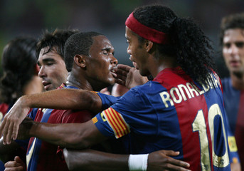 Barcelona's soccer players Eto'o and Ronaldinho celebrate goal against Bayern during friendly match in Barcelona