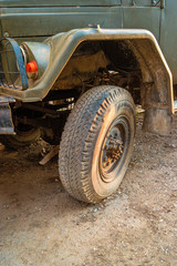 Detail of a soviet military truck vehicle tire over ground road