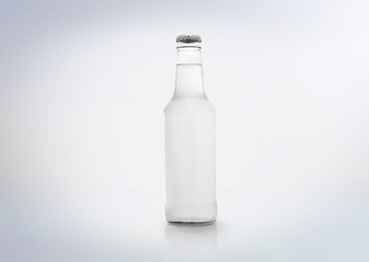 A ice soda glass bottle. Isolated on white background.