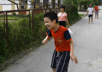 Agent Orange victims are seen at the Friendship Village, a hospice for victims, in Hanoi