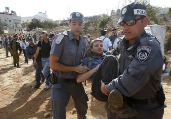 Israeli police officers arrest a demonstrator during a protest in Hebron