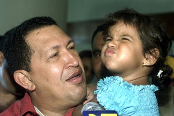 Three-year-old Brazilian girl Amanda Leite makes a funny face after being asked by Venezuelan Presid..