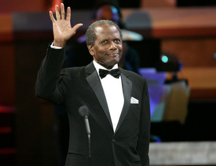 Actor Sidney Poitier waves after receiving the Distinguished Career award at the 2005 Black Movie Aw..