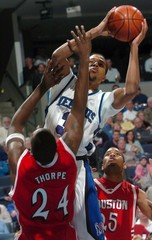 University of Memphis guard Douglas-Roberts shoots over University of Houston forward Thorpe during NCAA play in Memphis