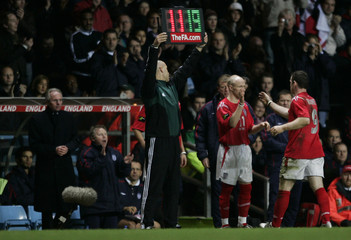 England's Rooney is substituted by new cap Johnson during their international friendly match against ...