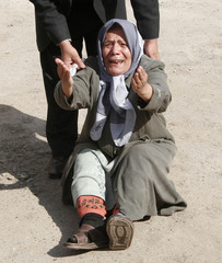 A woman cries after a relative was wounded in bomb attack in Kirkuk