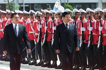 THAI DEFENCE MINISTER AND HIS MYANMAR COUNTERPART INSPECT AN HONOURGUARD IN BANGKOK.