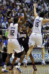 Philadelphia 76ers forward Iguodala is double teamed by Orlando Magic center Howard and forward Turkoglu in Orlando