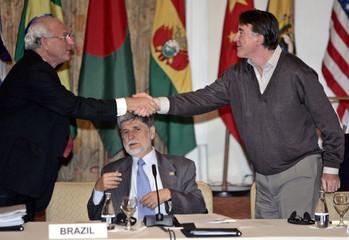 EU Trade chief Mandelson and Brazilian Agriculture Minister Pinto shake hands in Rio de Janeiro