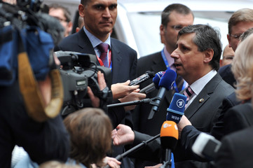 Czech Prime Minister Jan Fisher arrives at a two-day European Union leaders summit in Brussels
