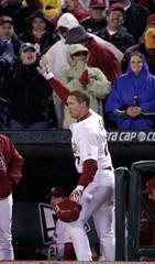 St. Louis Cardinals' Scott Rolen waves to crowd after hitting a two-run home run against Astros.