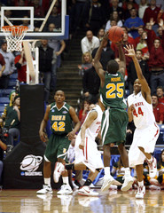 Siena College Moore shoots over Ohio State University Buford for the lead during their first round NCAA tournament basketball game in Dayton