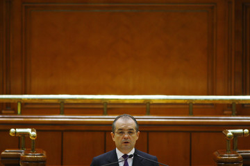 Romania's designate Prime Minister Boc addresses the Parliament ahead of confidence vote for his cabinet in Bucharest