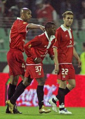 Benfica's Manuel Fernandes is congratulated by team mates by his goal against Setubal.