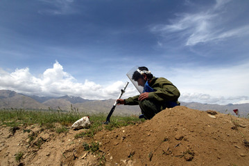 AFGHAN SAPPER SEARCHES FOR LANDMINES IN BAGRAM VALLEY.