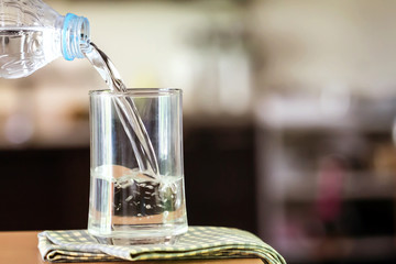 Glass of the purified water on the table bar in kitchenroom