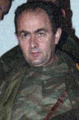 File photo shows former Bosnian Serb officer Zdravko Tolimir during a meeting in Sanski Most