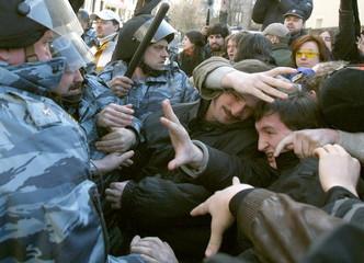 Russian police clash with opposition supporters protesting the detention of Chess grandmaster and opposition leader Garry Kasparov in central Moscow