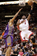 Miami Heat Wade goes up for the basket against the Phoenix Suns in Miami.