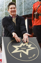 Canadian recording artist k.d. Lang poses with her star during Canada's Walk of Fame induction ceremonies in Toronto