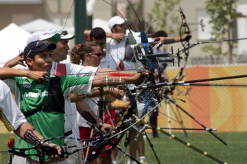 Archers aim during the archery practice session at the Dekelia training sport complex near Athens.
