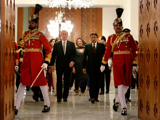 Bush and Musharraf arrive at a reception and state dinner in Islamabad