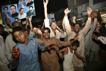 Supporters of President Musharraf celebrate his victory in the presidential election in Multan