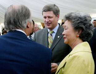 Conservative leader Harper meets with the Aga Khan while Canadian Governor General Clarkson looks on ...