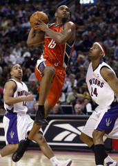 Charlotte Bobcats' Alan Anderson drives to the hoop in Toronto