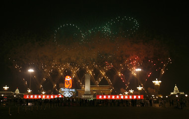 Fireworks explode over Tiananmen Square during the opening ceremony of the Beijing 2008 Olympic Games
