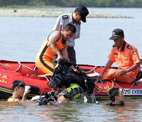 South Korean firemen conduct a search for missing soldiers on the Imjin river near the ...