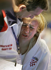 Narandja of Croatia reacts after being kicked during the European Karate Championships in Tenerife.