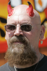 Paul Groenendal wears devil horns during 06/06/2006 event in Hell, Michigan