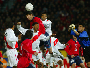 CHILEAN SOCCER PLAYER NORAMBUENA HEADS GOAL AGAINST PERU.