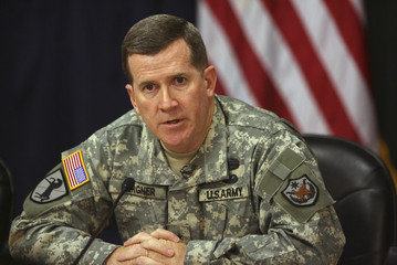 Brigadier General Kevin Bergner, U.S. military spokesman, speaks during a joint news conference in Iraq